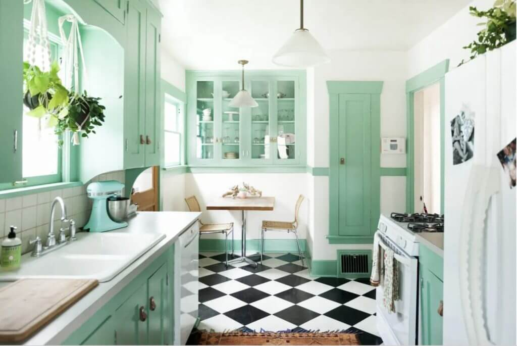 mint kitchen with black and white tiles