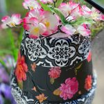 tissue paper and flowers on clay pot wind chime