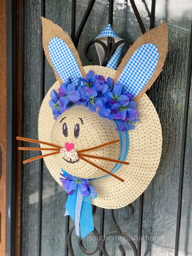 completed dollar tree sun hat bunny hat wreath on door