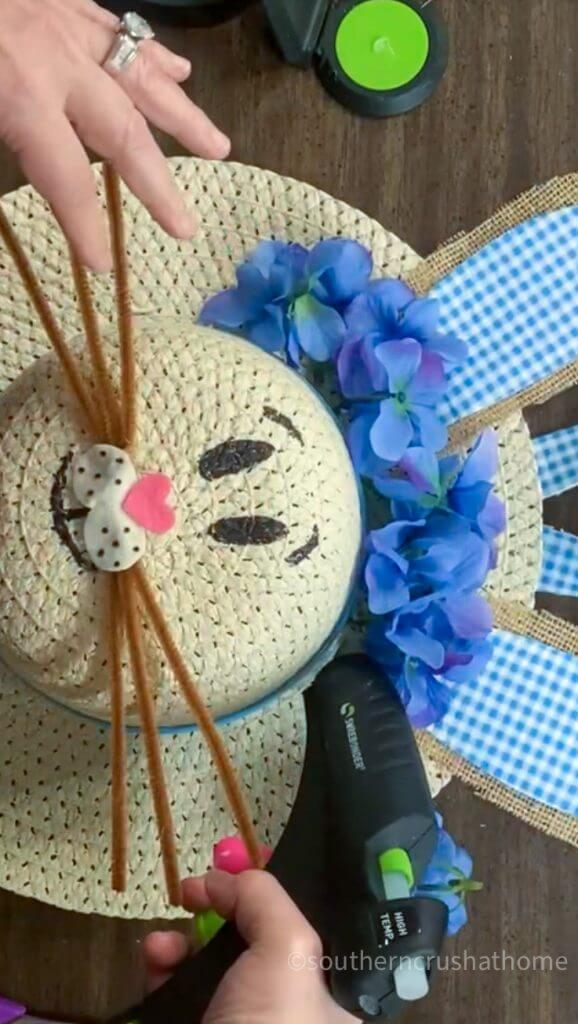 painting bunny face on sun hat