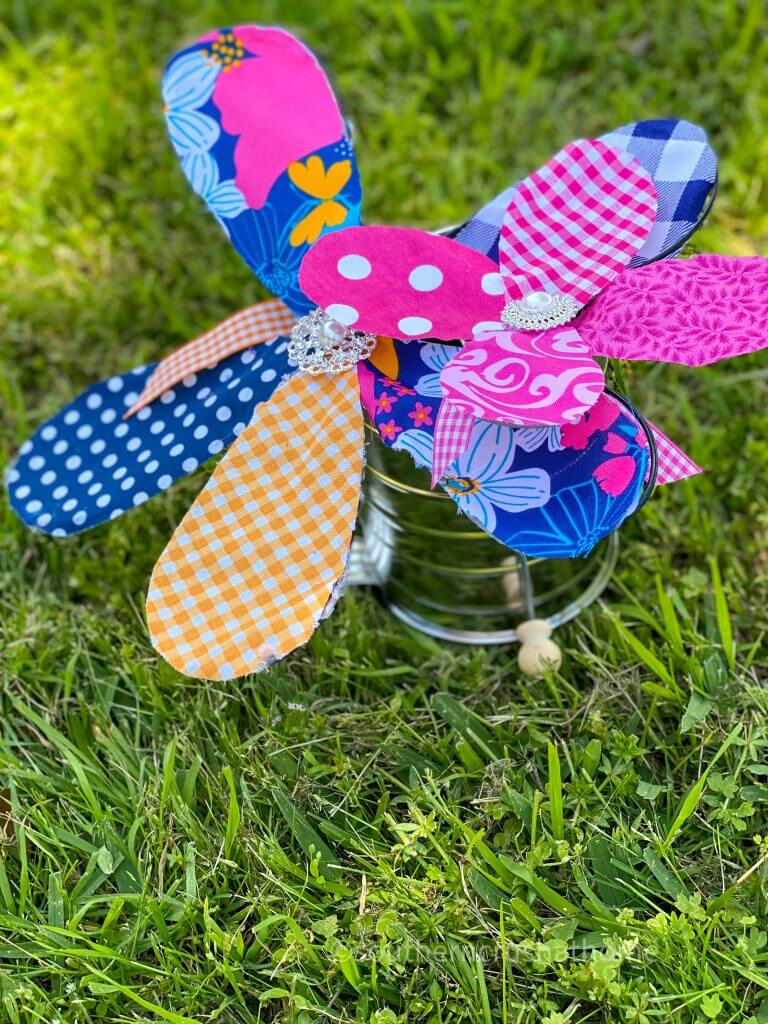 fabric flowers from kitchen whisk on grass