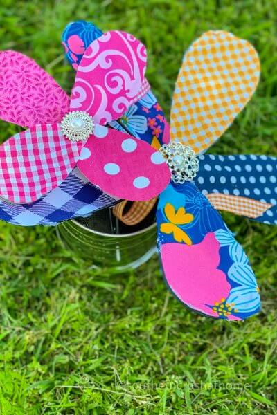two kitchen whisk fabric flowers in yard