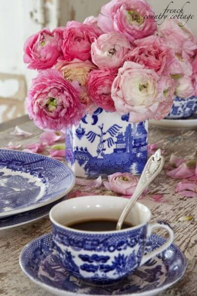 blue and white table decor with peonies