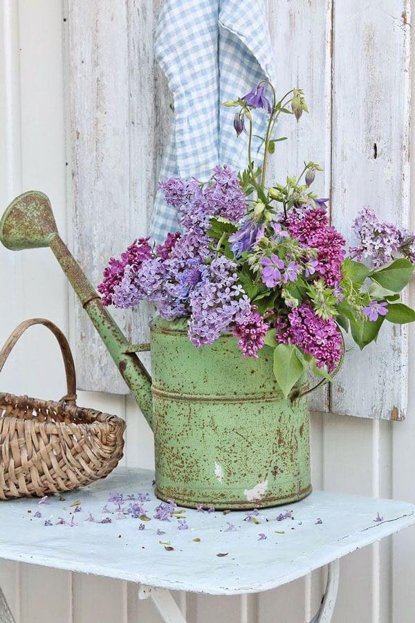 vintage watering can planter