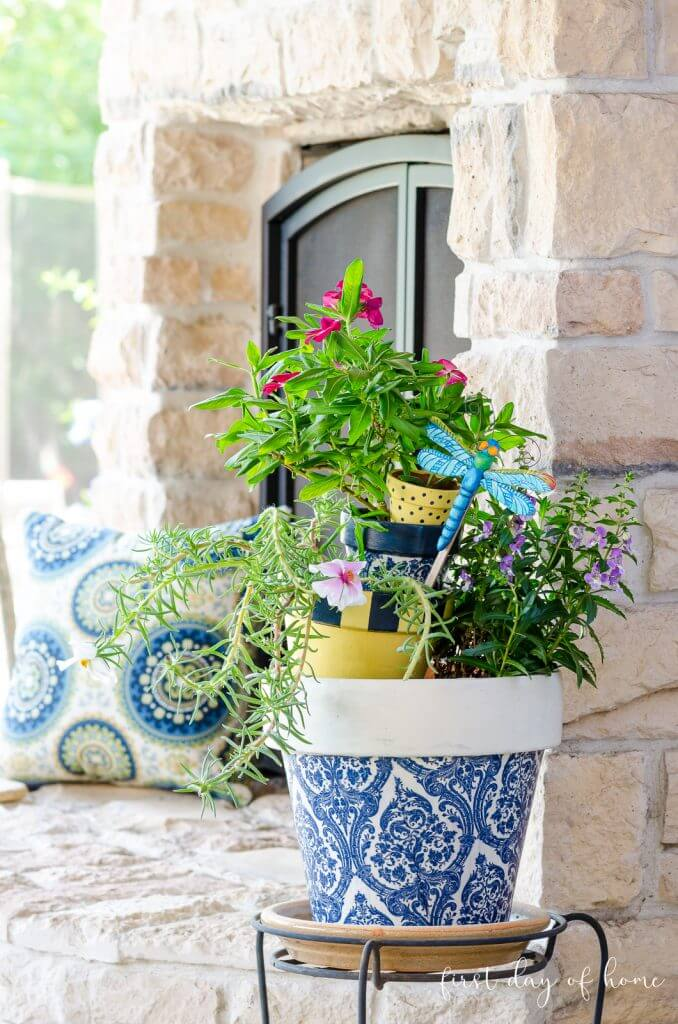 decoupaged clay pot on porch