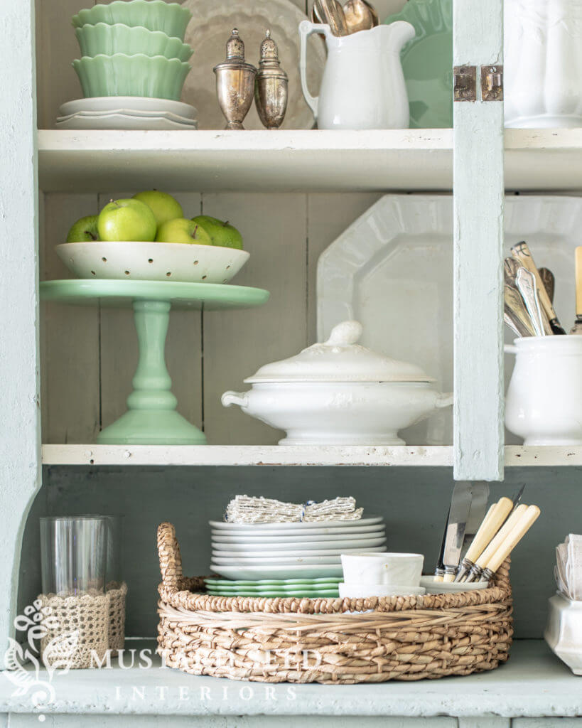 Kitchen hutch decorated with cake plates and ironstone