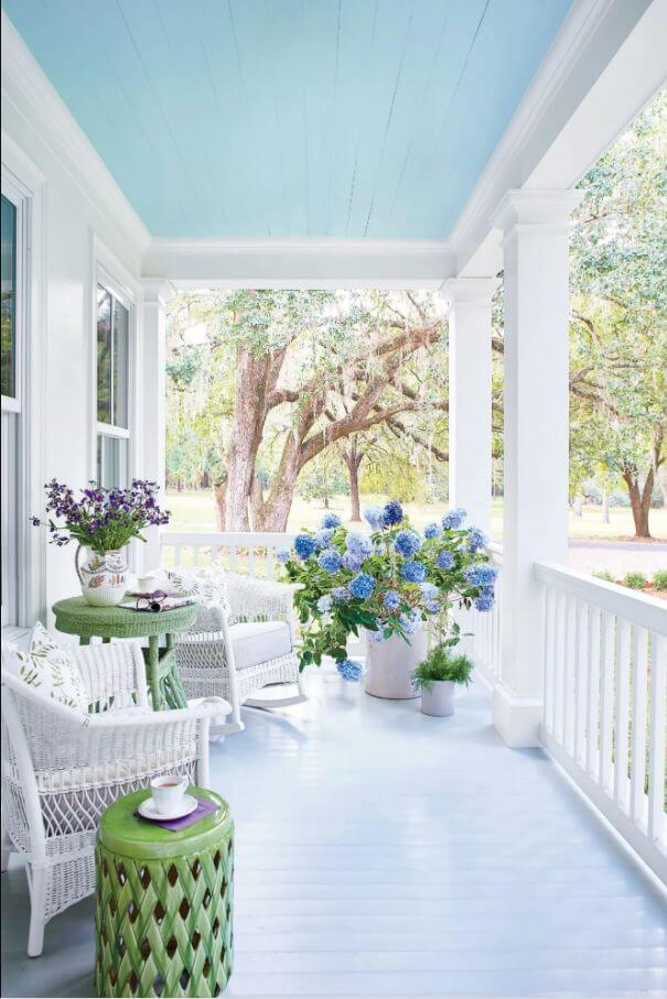 blue and white summer front porch with hydrangeas