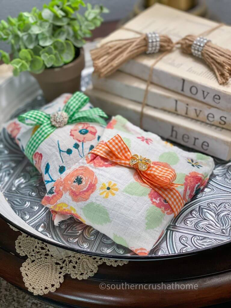 swaddle blanket muslin sachets styled on tray