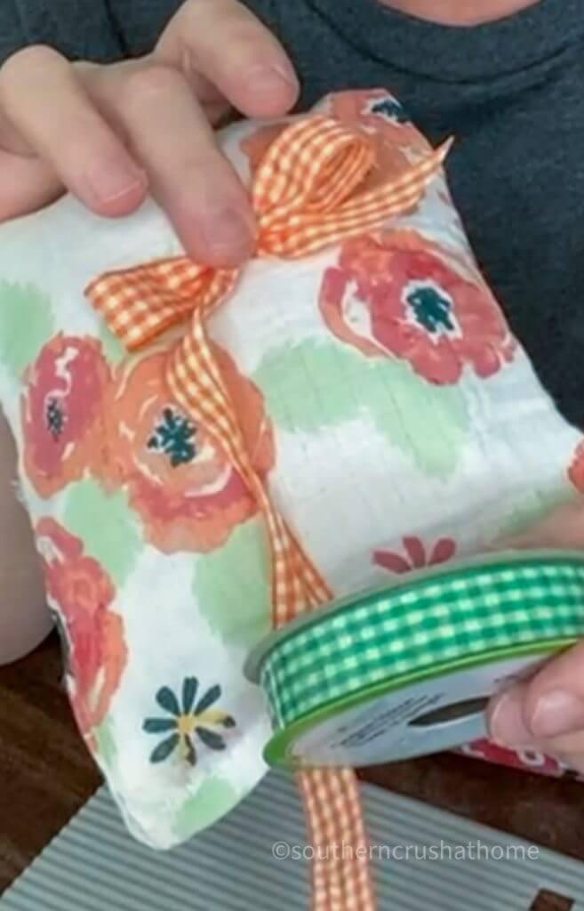 adding ribbon to sachets