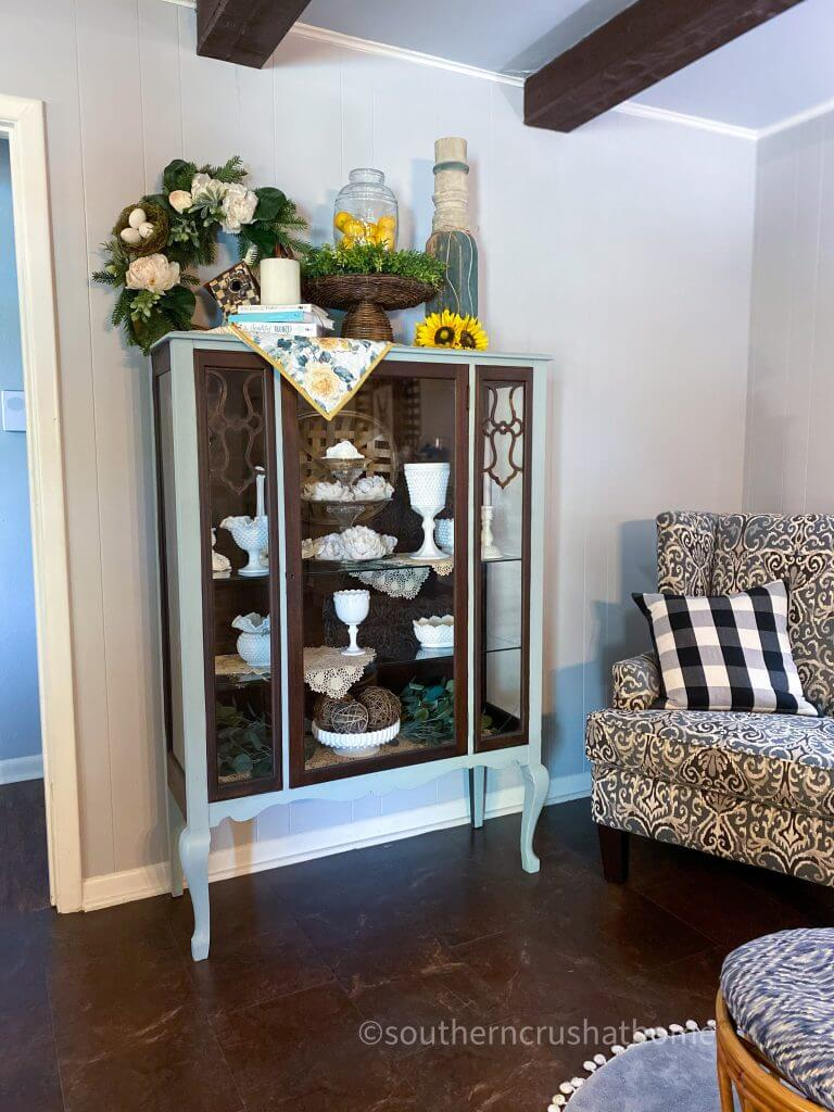 completed vintage cabinet makeover with collection