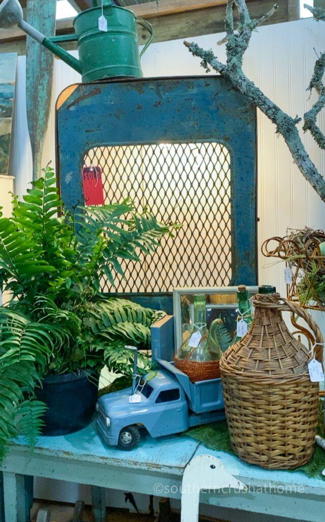 blue farmhouse truck wicker bottle fern