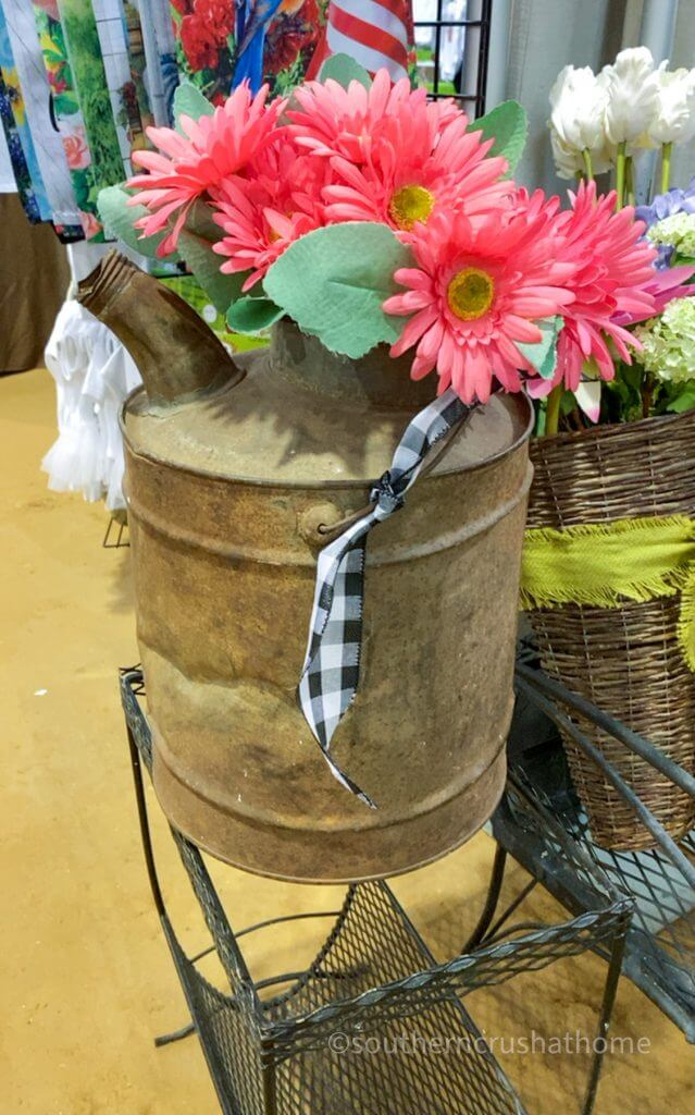 gasoline can with faux flowers and buffalo check ribbon