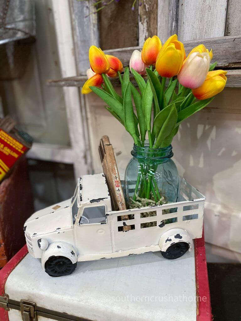shabby chic farmhouse cream colored truck with faux tulips