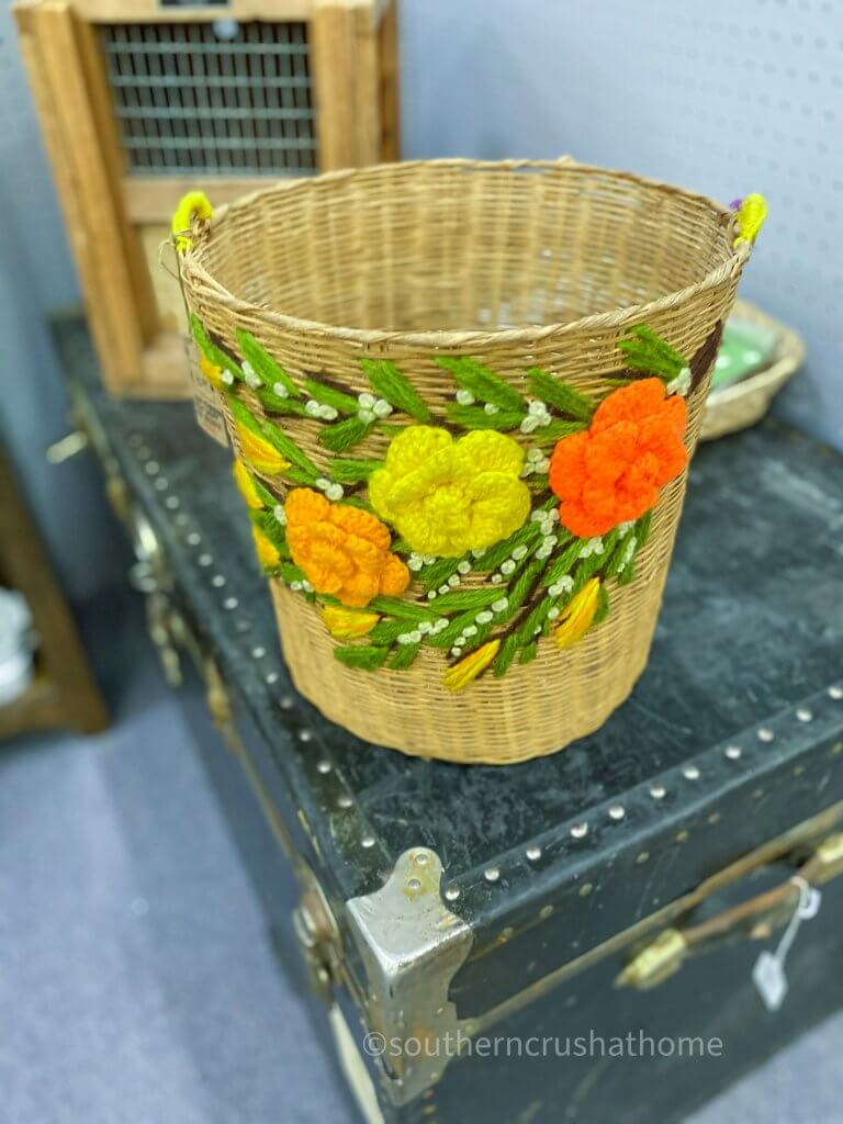 vintage waste basket with yarn flowers