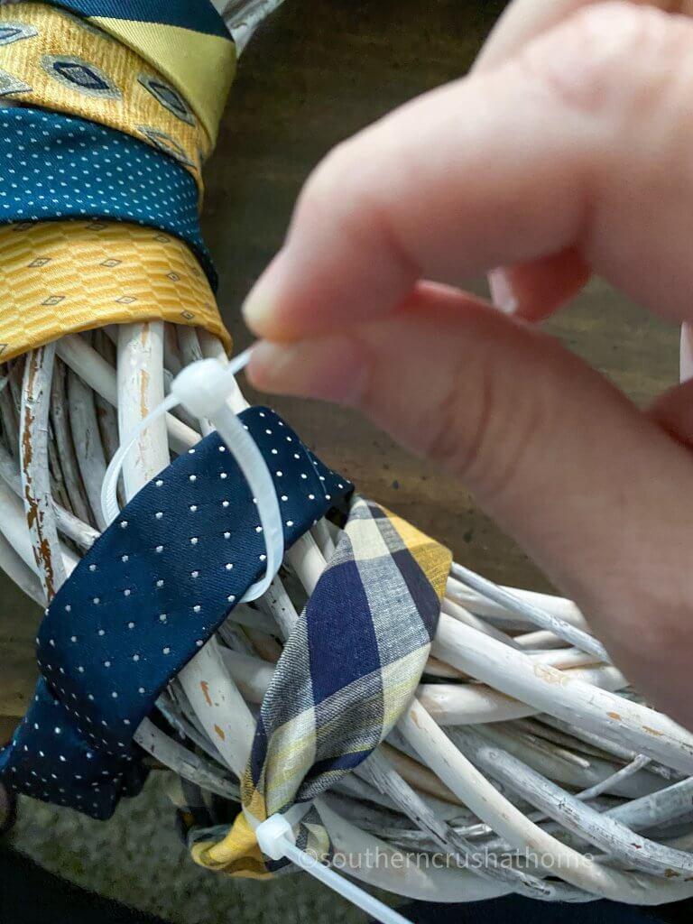 using zip ties to secure neckties to wreath
