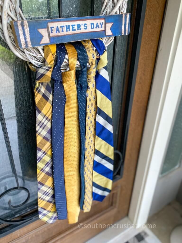 close up of necktie wreath on front door