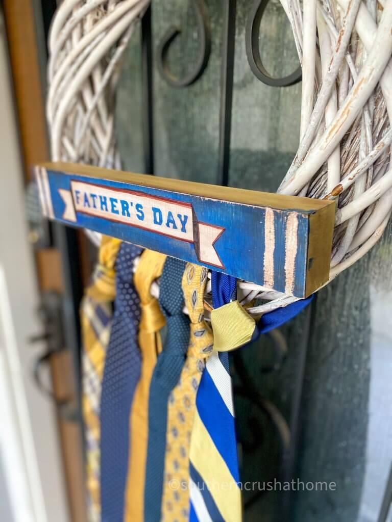 side view of necktie wreath on door