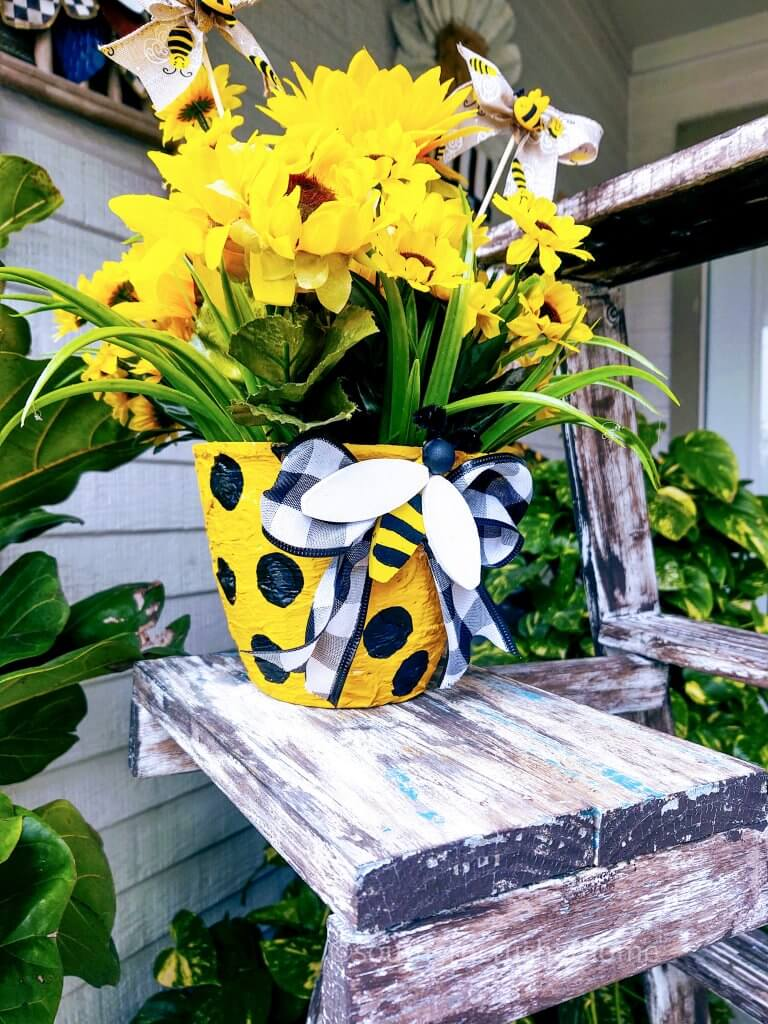 diy textured flower pot with yellow flowers on table