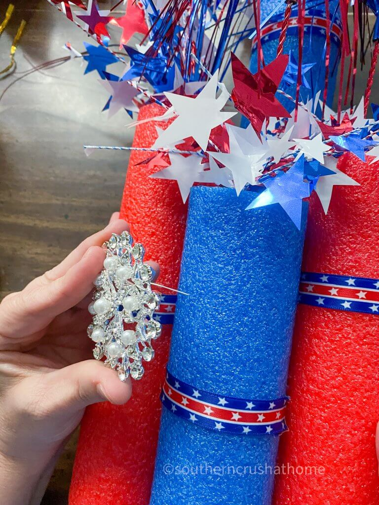 securing embellishment to firecracker pool noodle