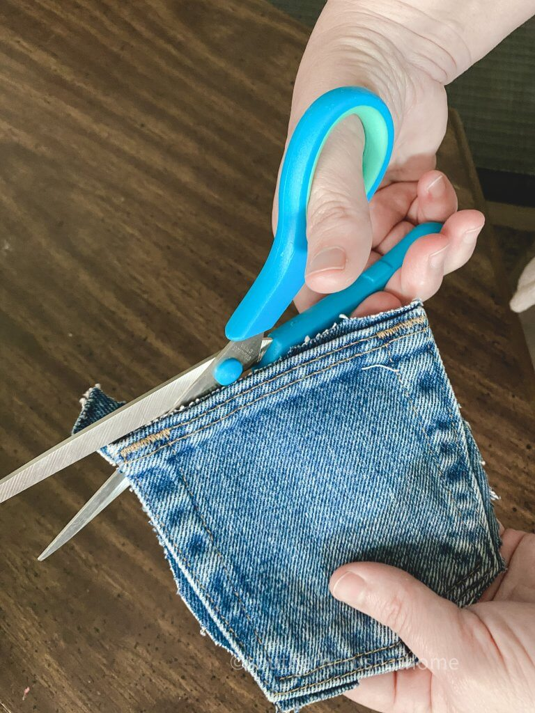 cutting jean pockets