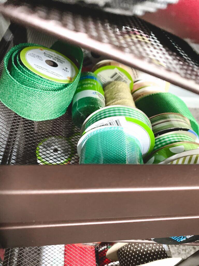 green ribbons on storage rack