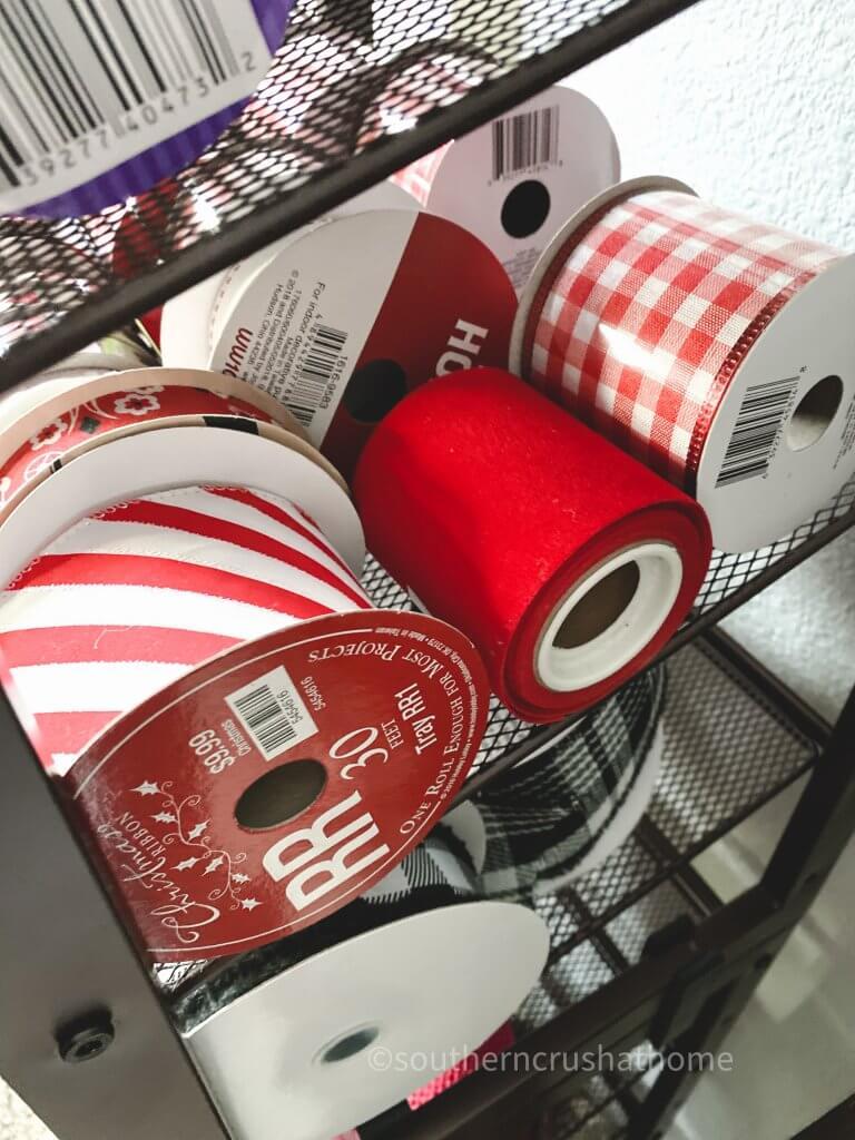 red ribbon on ribbon rack