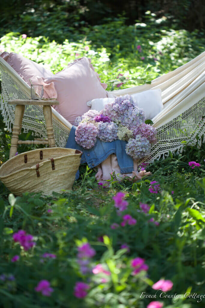 beautiful hammock with flowers and basket