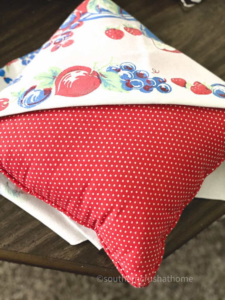 thrift store pillow with fabric makeover