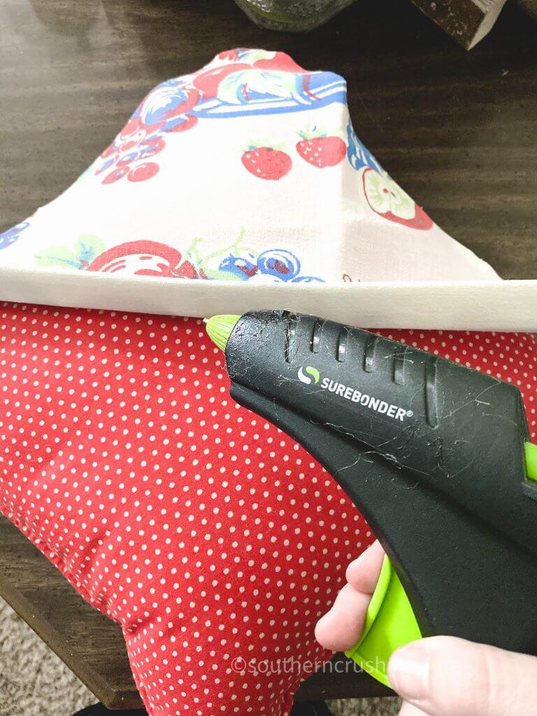using hot glue gun on fabric pillow