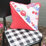 finished thrift store pillow makeover on chair