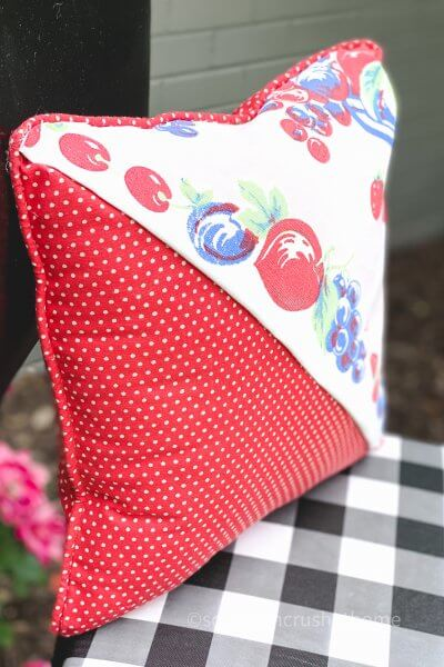 thrift store pillow makeover on chair