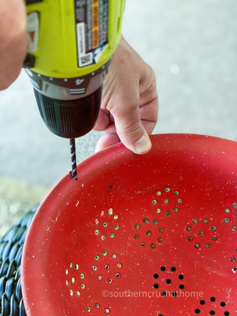 drilling hole in colander