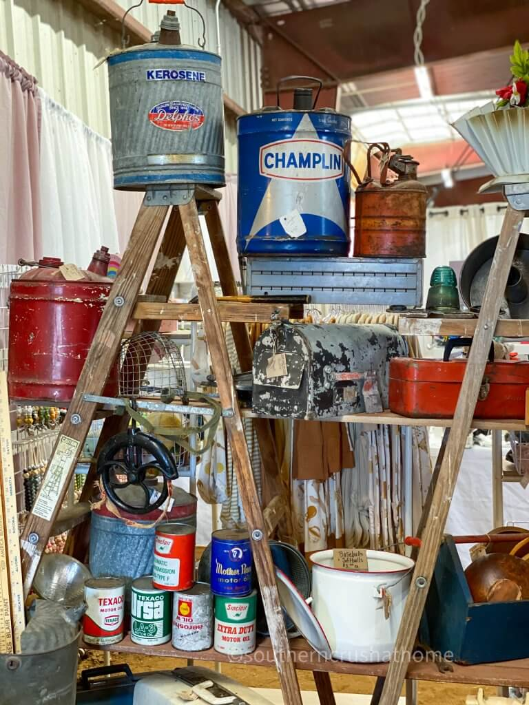 various vintage rustic metal gasoline cans and oil cans