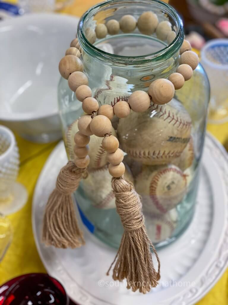 baseball collection in a jar with wooden beaded tassel