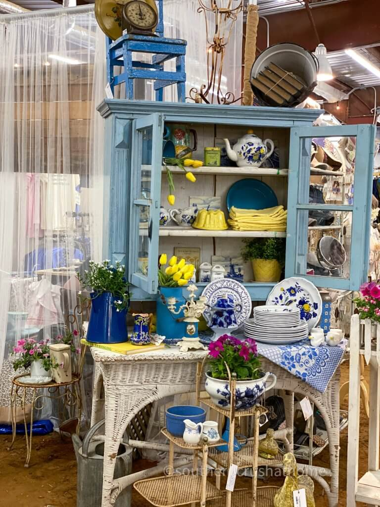 blue and white dishes in vintage cabinet display