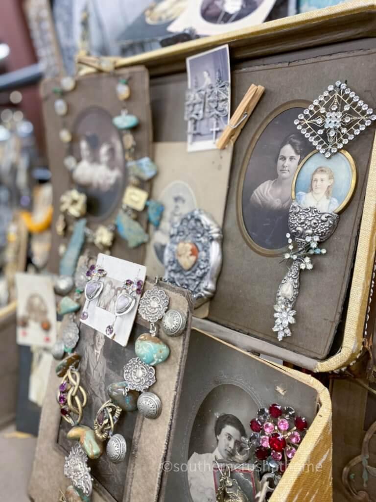 vintage photographs displaying handmade jewelry closeup