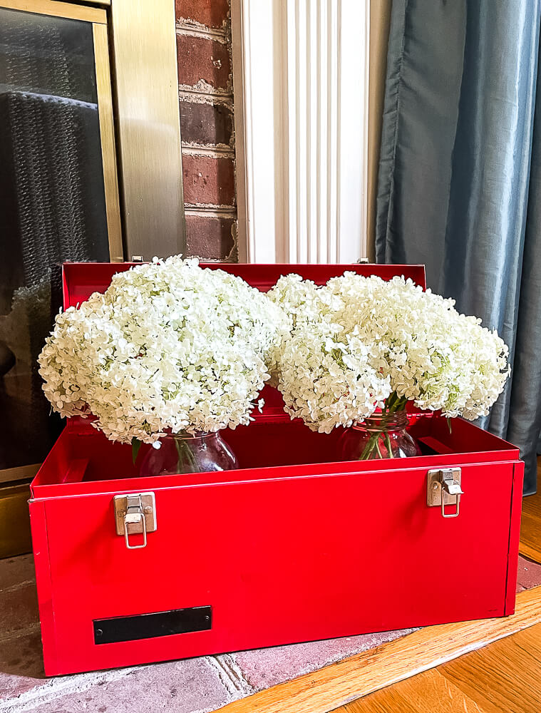 Red toolbox with hydrangeas