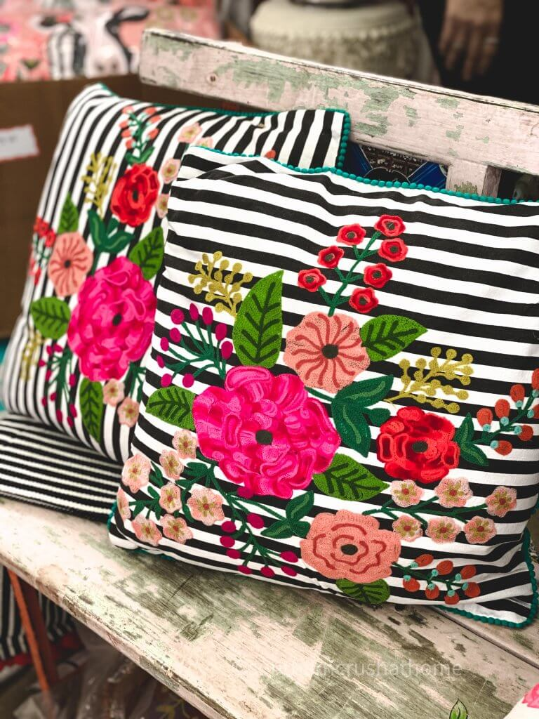 bright flowers on a black and white striped pillow