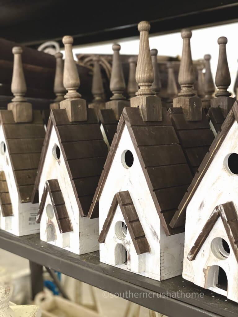 row of wooden bird houses