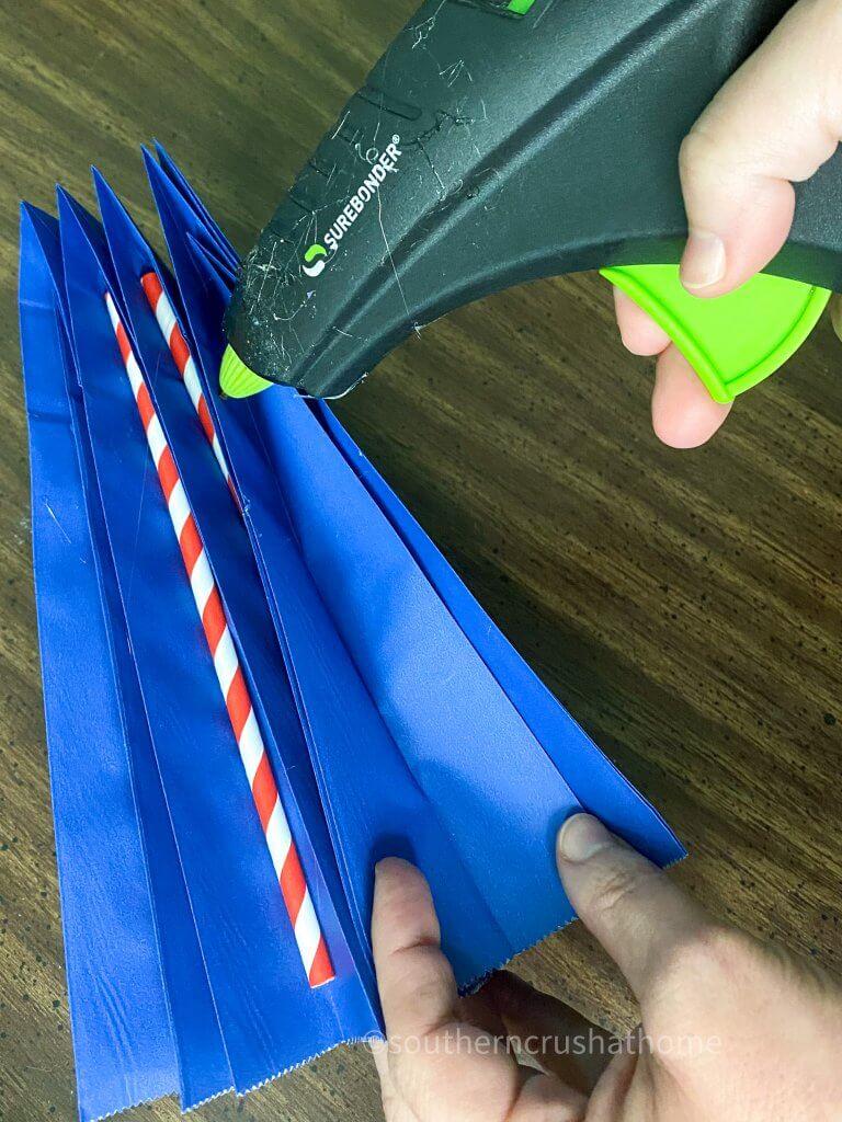 adding straws to dollar tree gift bag