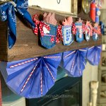 Dollar Tree Gift Bag Patriotic Bunting hanging on mantel