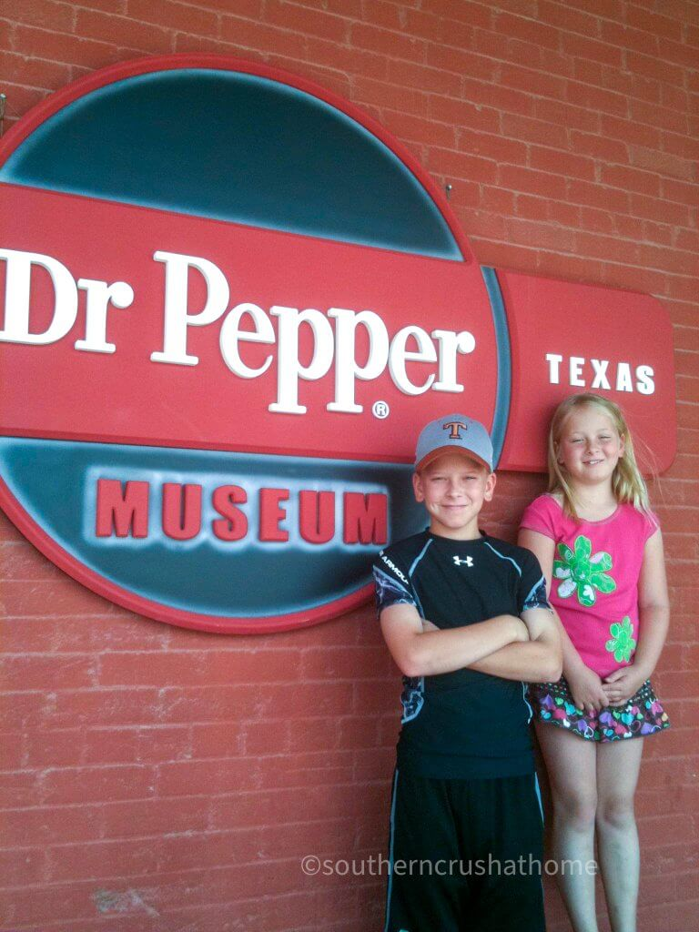 kids in front of the Dr Pepper museum in Waco TX