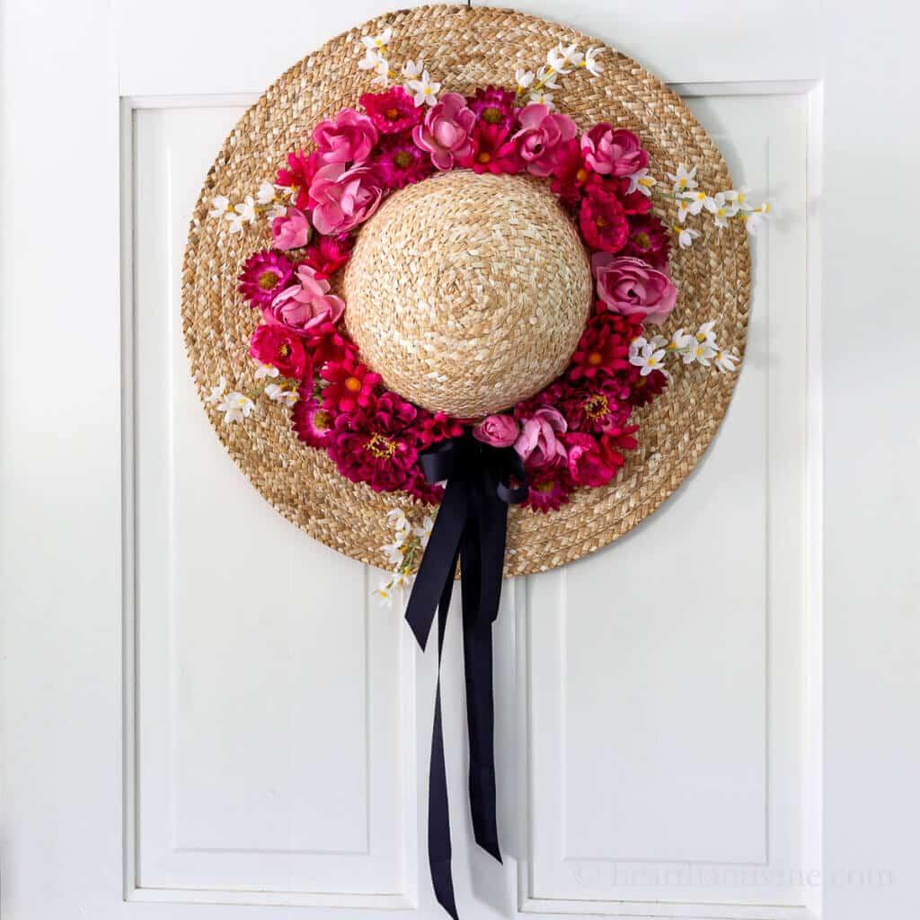 straw wreath hat on door