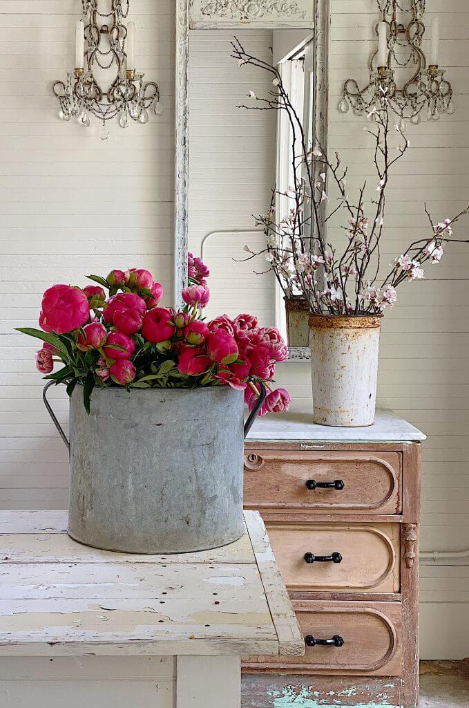 galvanized bucket on counter with flowers