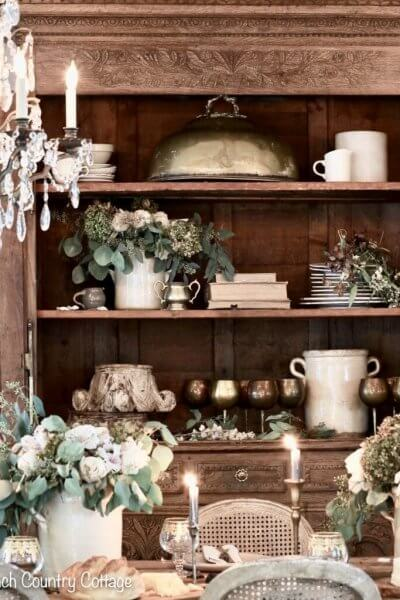 dining room hutch with flowers