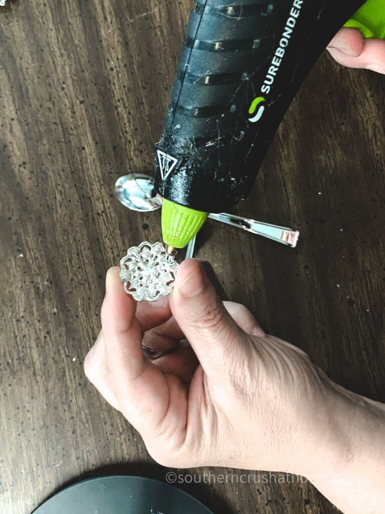 using hot glue to attach embellishment on dragonfly