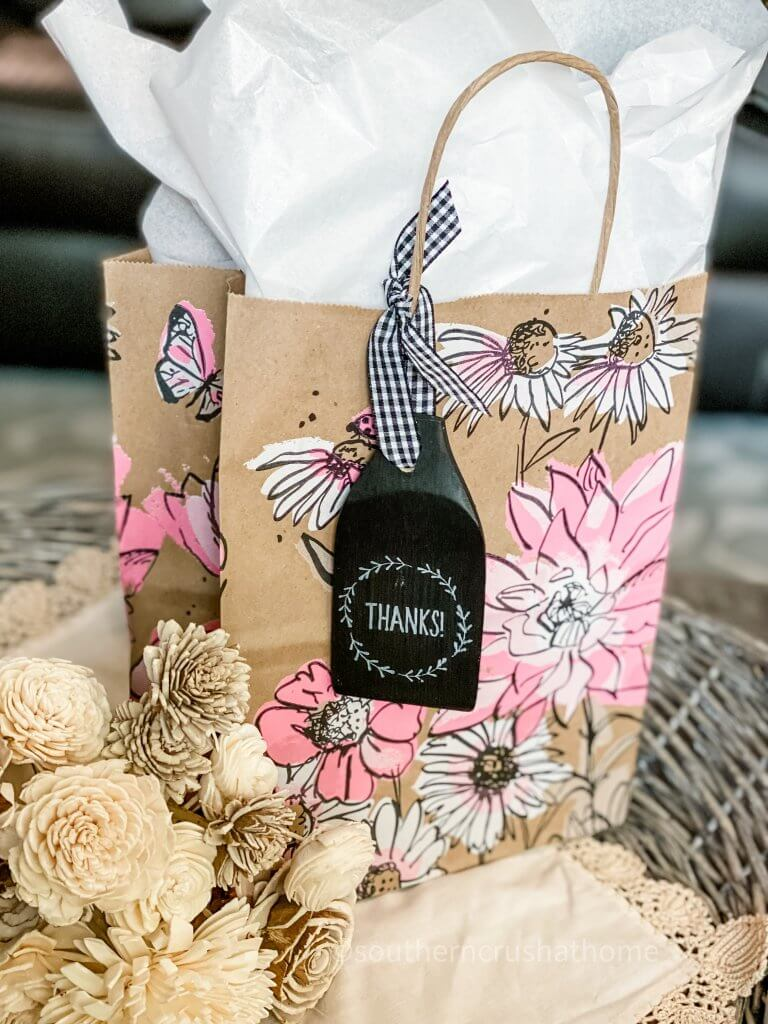 DT Wooden Spatula Gift Tag displayed on a gift sack