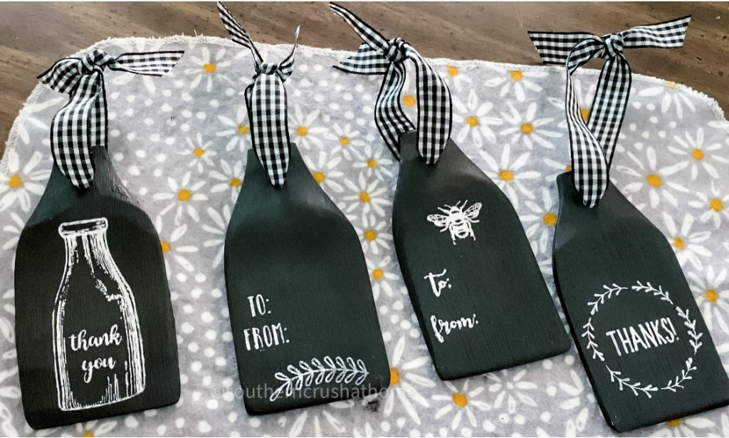 Several designs of dollar tree wooden spatula gift tags completed
