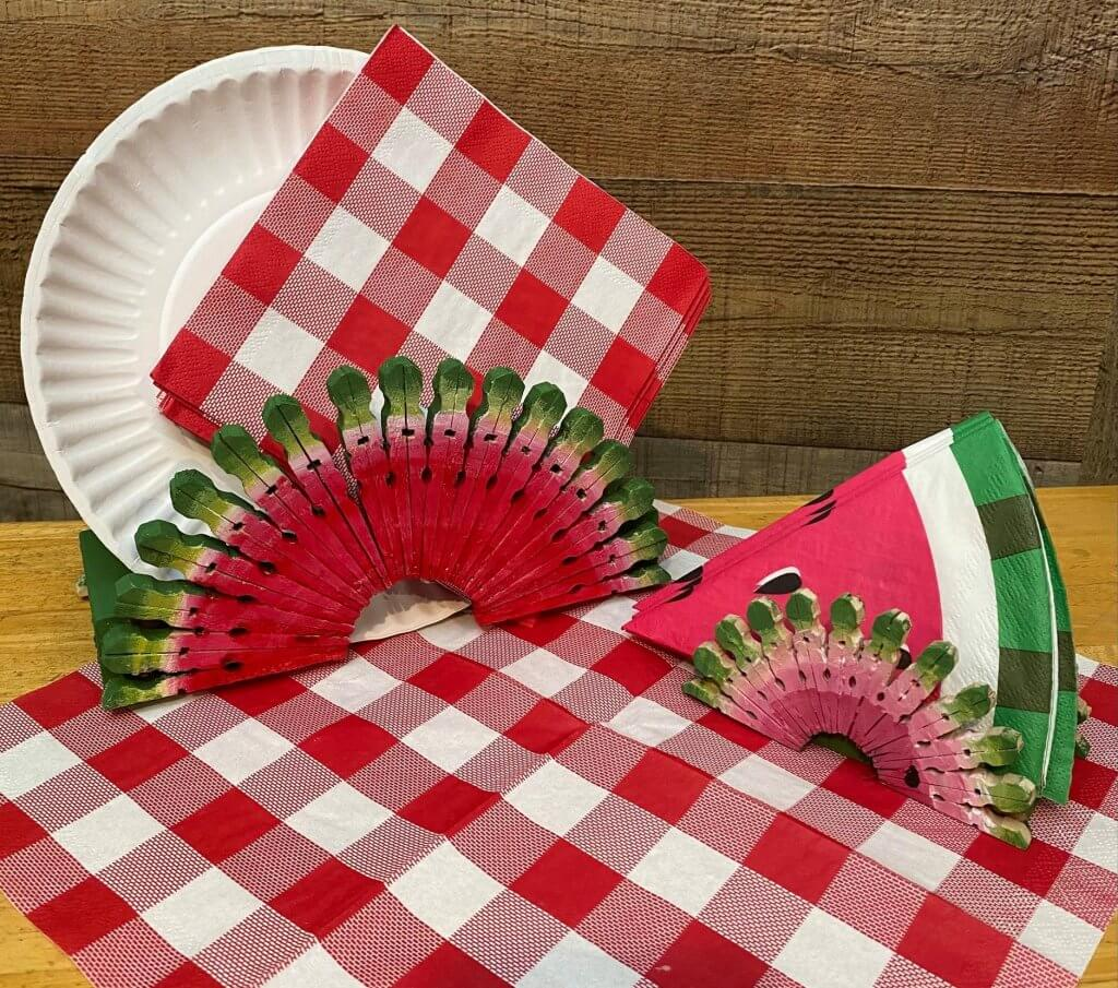Dollar Tree Paper Plate Napkin Holder on table with napkins and plates