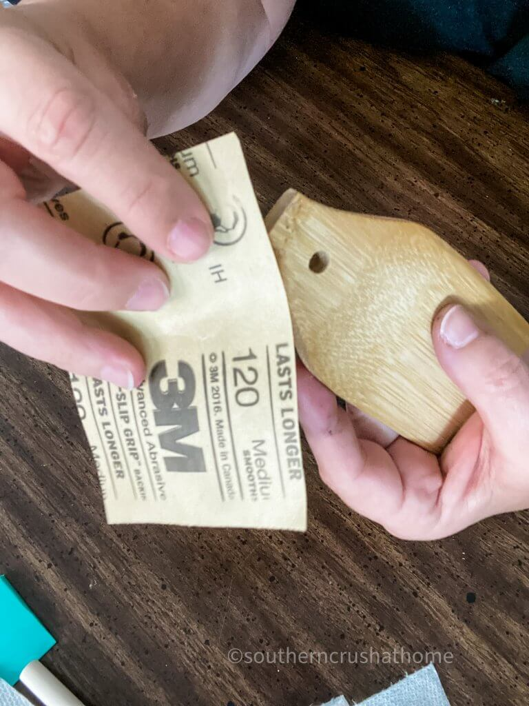 sanding wooden tag